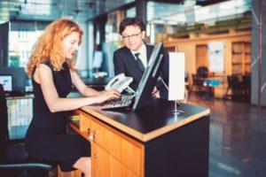 Bank receptionist helping customer, businessman.